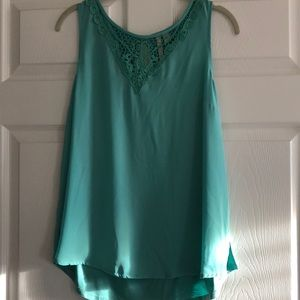 Turquoise green sleeveless blouse